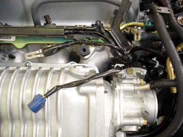 Using the supplied new throttle body gasket and original hardware, mount the throttle body to the blower inlet manifold.
