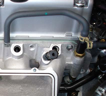 Move the harness to the engine side of the thermostat housing tab and secure it