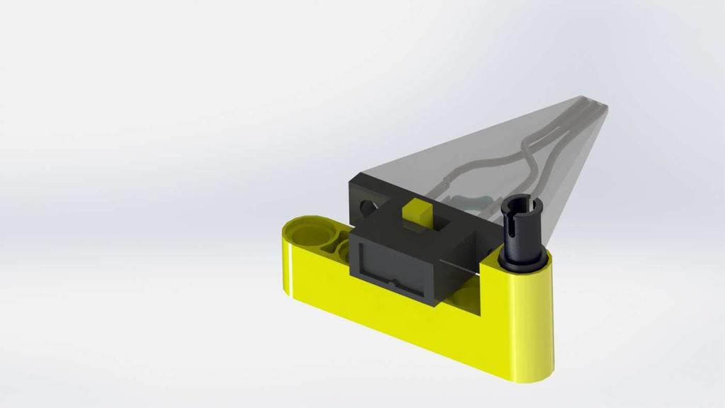 Alternate form of an actuator mounted into the designed Lego -coupler (yellow part) The alternate form of the coupler is quite similar to the original.