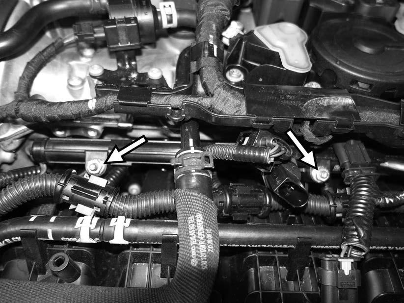 101) After making sure all the injector electrical connectors are facing directly to the right side of the car, push the fuel rail down to full seat it.