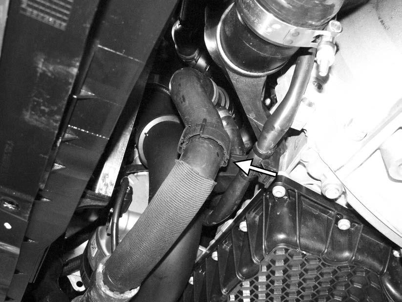 109) Reconnect the clamp holding the lower radiator hose to the front of the engine.
