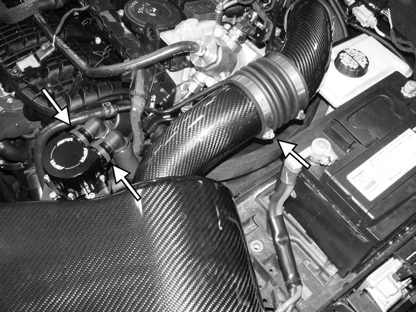 55) Loosen the clamp holding the APR intake to the rear intake pipe.