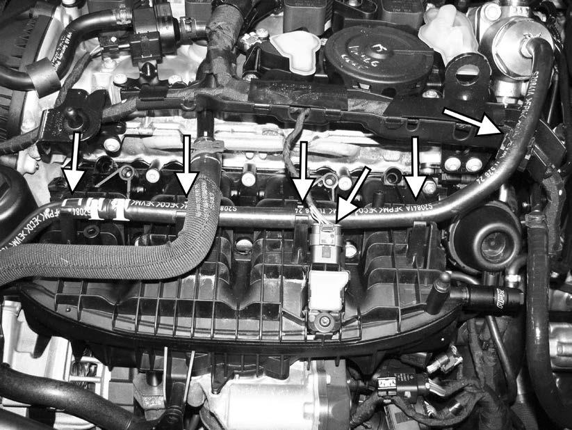 63) Separate the fuel feed line from the five mounting points along the intake manifold.