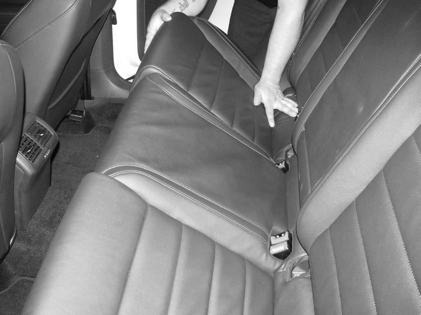 3) Lift up on the front of the bottom of the rear seat.