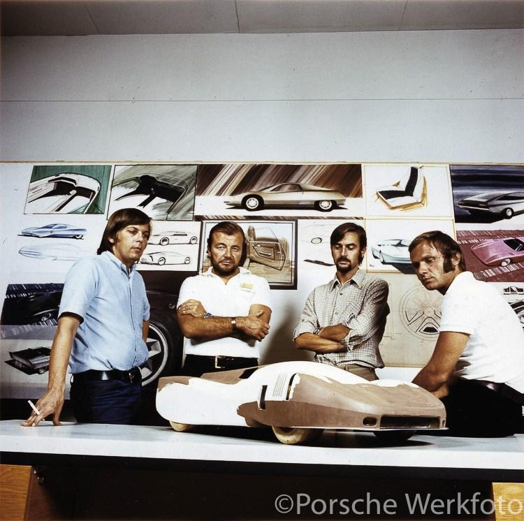 Chief Designer, Anatole Lapine (second from left) in the Design Dept. with colleagues and a Porsche model, ca.