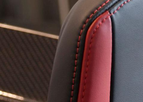 Sewing in combination with the graphic design of the vehicle Leather: Quality: Corrected grain Finish: Corrected
