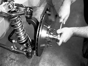 To fully seat the bearings, tighten the castle nut to 12 lb-ft while turning the rotor