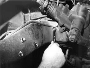 Disconnect the brake line clamp by the