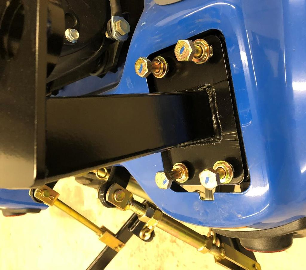 . Take the wider flasher light bracket and position onto the left rear bracket, the bent end will be on the outside. Use the remaining two factory ROPS fasteners for the two bolts.