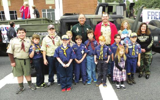 Accompanying the Humvee was Cub Scout Pack 79.