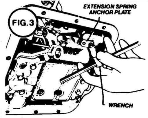 Use hacksaw to cut protruding part of the transmission away to allow cable bracket installation. Clean all metal chips away from the transmission before removing the oil pan. Remove all stock linkage.