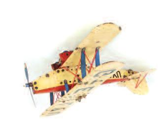 length and 54cm wingspan, with operable motor and integral key present, finished in silver with RAF roundels to wings, detailed in shades of red and blue, missing the battery operated central light,