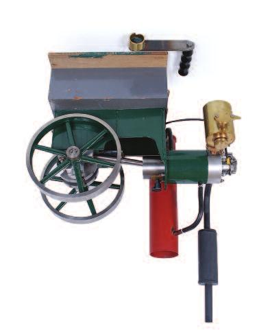 Lot 84 Lot 86 84 1/4 scale petrol driven hit and miss engine, with single cylinder driving geared twin flywheels of 9 inch diameter, brass carburettor and single spark plug, measure 21 inches long,