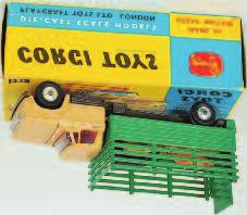 Lot 1662 1662 Corgi Toys, 484 Dodge Kew Fargo livestock transporter, beige cab with grey chassis, green back, spun hubs, 5 plastic animal pigs, in the original blue and yellow box (NM,BVG) 50-80 1663