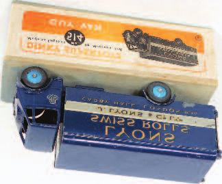 all card orange and white labelled box, surfaces chips to model (G-VG-BVG) 150-200 1904 Dinky Toys, 514 Lyons Guy van, dark blue first type cab, chassis and back, mid-blue rigid hubs, Lyons Swiss