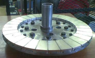 Table : Design Data of Base Machines Single Layer Double Layer Stator outer diameter, mm 330 330 Total axial length, mm 55 55 Diameter Ratio 0.69 0.652 Magnet arc to pitch ratio, r f 0.95 0.