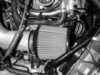 Use the supplied 1 hose clamp on the AEM intake pipe nipple and the original hose clamp on the valve cover nipple. g.
